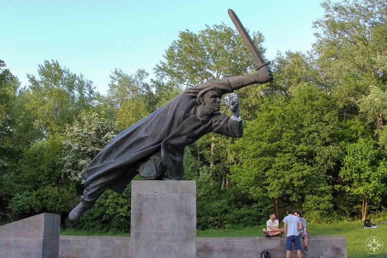 Guys hanging out at Spanish Civil War Memorial in Volkspark Friedrichshain