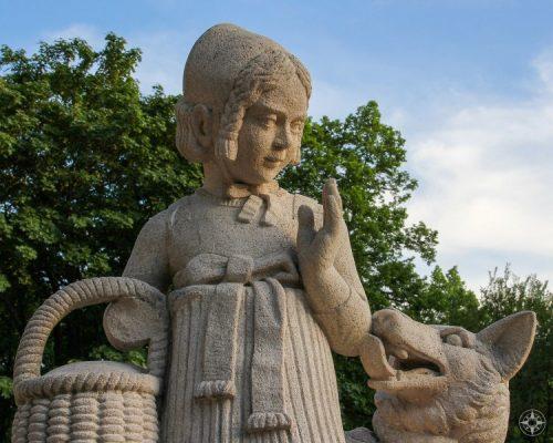 Little Red Ridinghood (Rotkaeppchen) getting licked by the Big Bad Wolf at Maerchenbrunnen, Fariy Tale Fountain, Friedrichshain