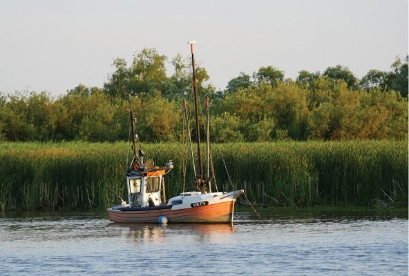 Classic fishing boat on the Elbe River, Germany, postcard