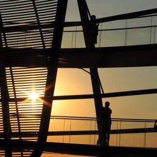 Golden Hour sun seen through Reichstag glass dome, Berlin, Germany, sunset postcards