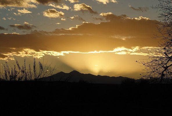 Sun rays behind the Rocky Mountains, Longs Peak, Meeker, Colorado, sunset sky postcards