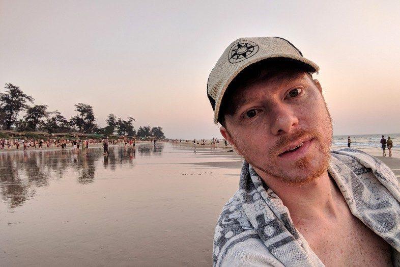 Happier Ambassador Adam, Goa, India, Happier Place burlap trucker hat, beach, Travels of Adam