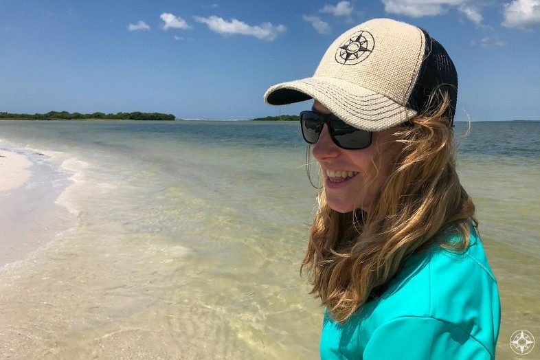 Happier Ambassador Judith on Three Rooker Island in Florida wearing a Happier Place burlap trucker hat