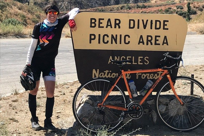 Happier Place ambassador Lisa and bike at Bear Divide Picnic Area in the Angeles National Forest