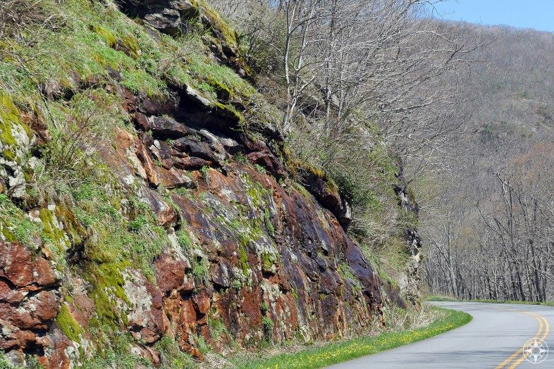 Colorful rock walls covered in lichen and moss, highway, Blue Ridge Parkway, mountains
