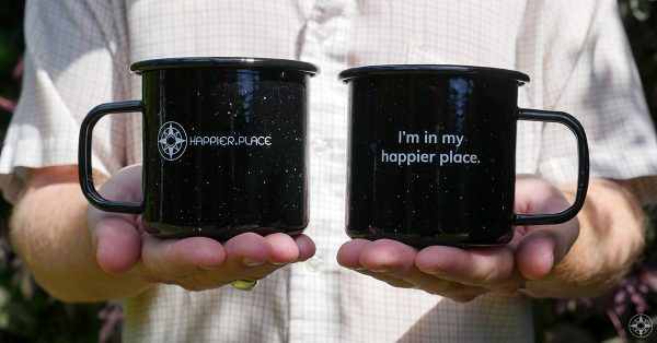 "Black speckled ""I'm in my happier place."" enamel metal mug, front and back"