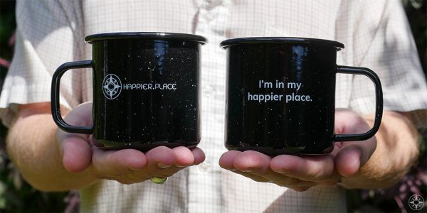"Black speckled ""I'm in my happier place."" enamel metal mug, front and back"