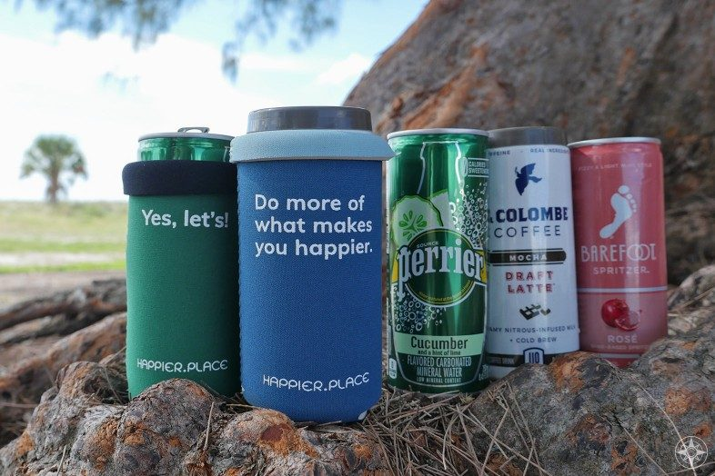 Happier Place Slim Can Cooler folded over fits La Colombe draft latte, Barefoot Wine Spritzers, Perrier short cans, Yes let's do more of what makes you happier