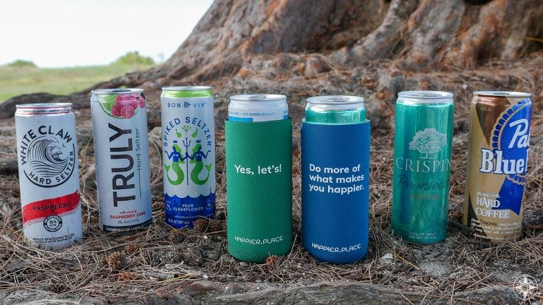 Happier Place slim can coolers fit White Claw, Truly, Bon and Viv spiked and hard seltzers, Crispin hard cider, Pabst Blue Ribbon hard coffee, Yes let's, do more of what makes you happier