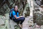 Jessica Tejera, The Walking Mermaid, resting along rocky trail