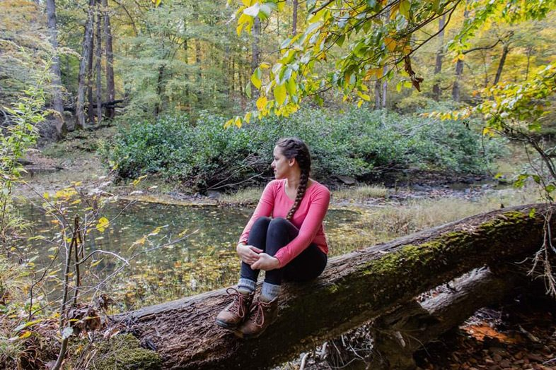 Jessica Tejera, The Walking Mermaid, sitting on a long in the Shawnee National Forest, Illinois