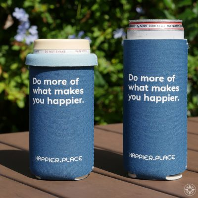 The indigo blue 'Do more of what makes you happier' slim can cooler by Happier Place fits tall and short slim cans (8 - 12 oz.)