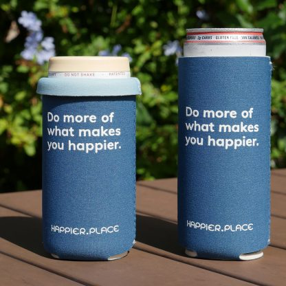 """Happier Place indigo """"Do more of what makes you happier"""" Slim Can Cooler fits 12 oz and 9 oz slim cans."""