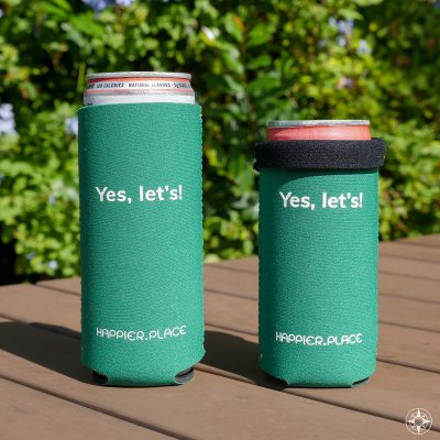 The Happier Place evergreen Yes, let's! Slim Can Cooler is perfectly sized for 12 oz and 9 oz slim cans. H023-CAN-YL-GRD
