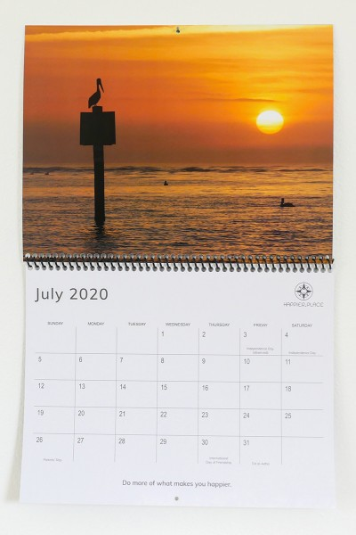 2020 Happier Place Calendar, nature photography, July page, pelican watches sunset, Florida