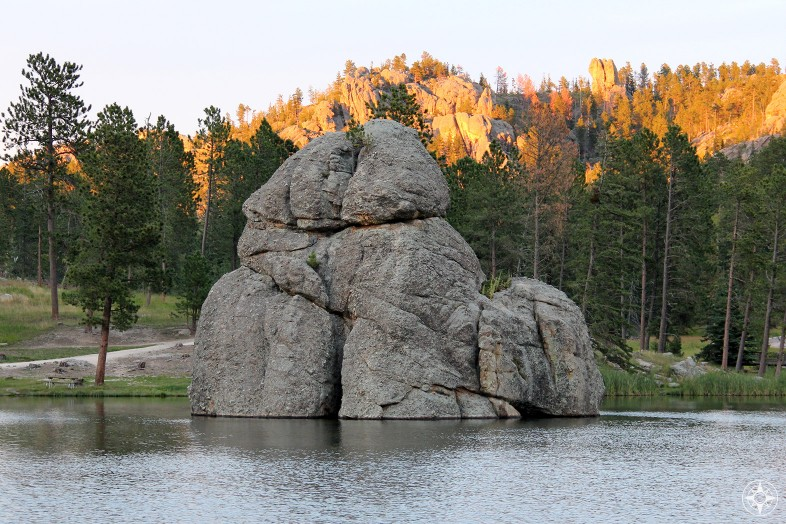 Rocks hugging and kissing during romantic Golden Hour at Sylvan Lake, South Dakota.