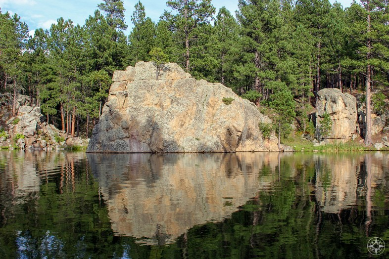 Rock and trees reflection in lake, Custer State Park, Happier Place