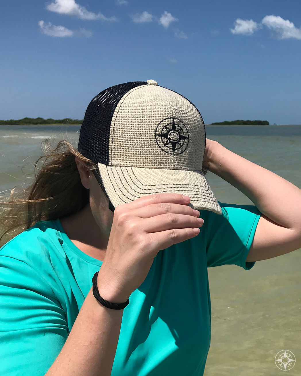 Happier Place burlap trucker hat with stitched on black compass logo... worn by Judith off Three Rooker Island, St. Joseph Sound, Florida. 