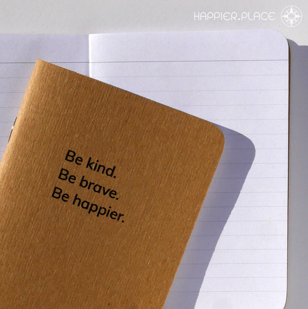 The Happier Place \'Be kind. Be brave. Be happier.\' pocket-sized notebook with lined pages is made to tag along with you anywhere.