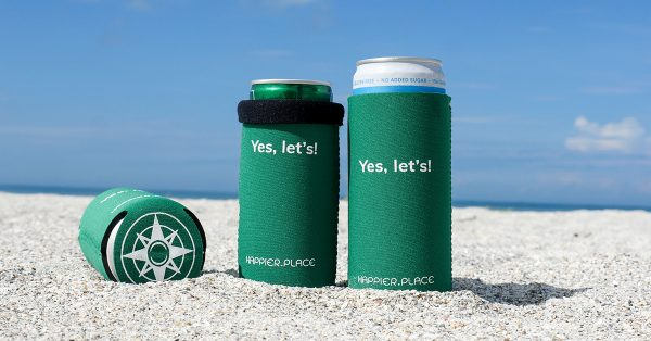 The Happier Place evergreen Yes, let's! Slim Can Cooler is perfectly sized for 12 oz and 9 oz slim cans.