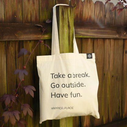 Take a break shoulder bag by Happier Place hanging outside
