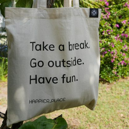 Take a break shoulder bag by Happier Place hanging outside