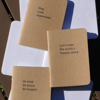 Happier Place books, blank notebooks, with inspiring slogans