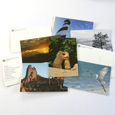 Happier Place postcards featuring outdoor and nature photography, multiple choice cards, kissing prairie dogs, garden of the gods, lighthouse, snow, rocky mountain sunset