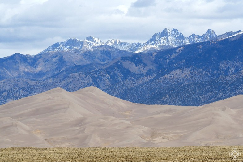 Great Sand Dunes National Park, Colorado, tall sand dunes and snow-peaked mountains