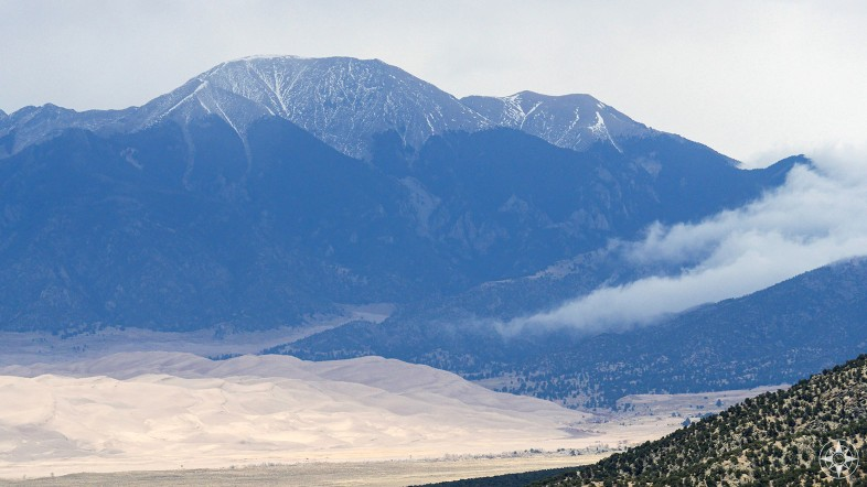 View of the Great Sand Dunes dune field in the San Luis Valley and the Sangre de Cristo Mountain Range from the Zapata Falls Trail. Colorado