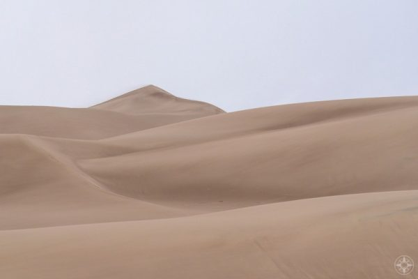 Sand dunes peak with blowing sand, Great Sand Dunes, Colorado