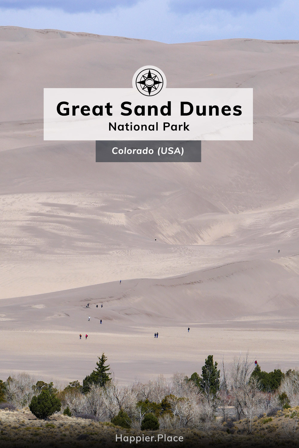 People hiking, sledding, snowboarding the Great Sand Dunes National Park Colorado Happier Place