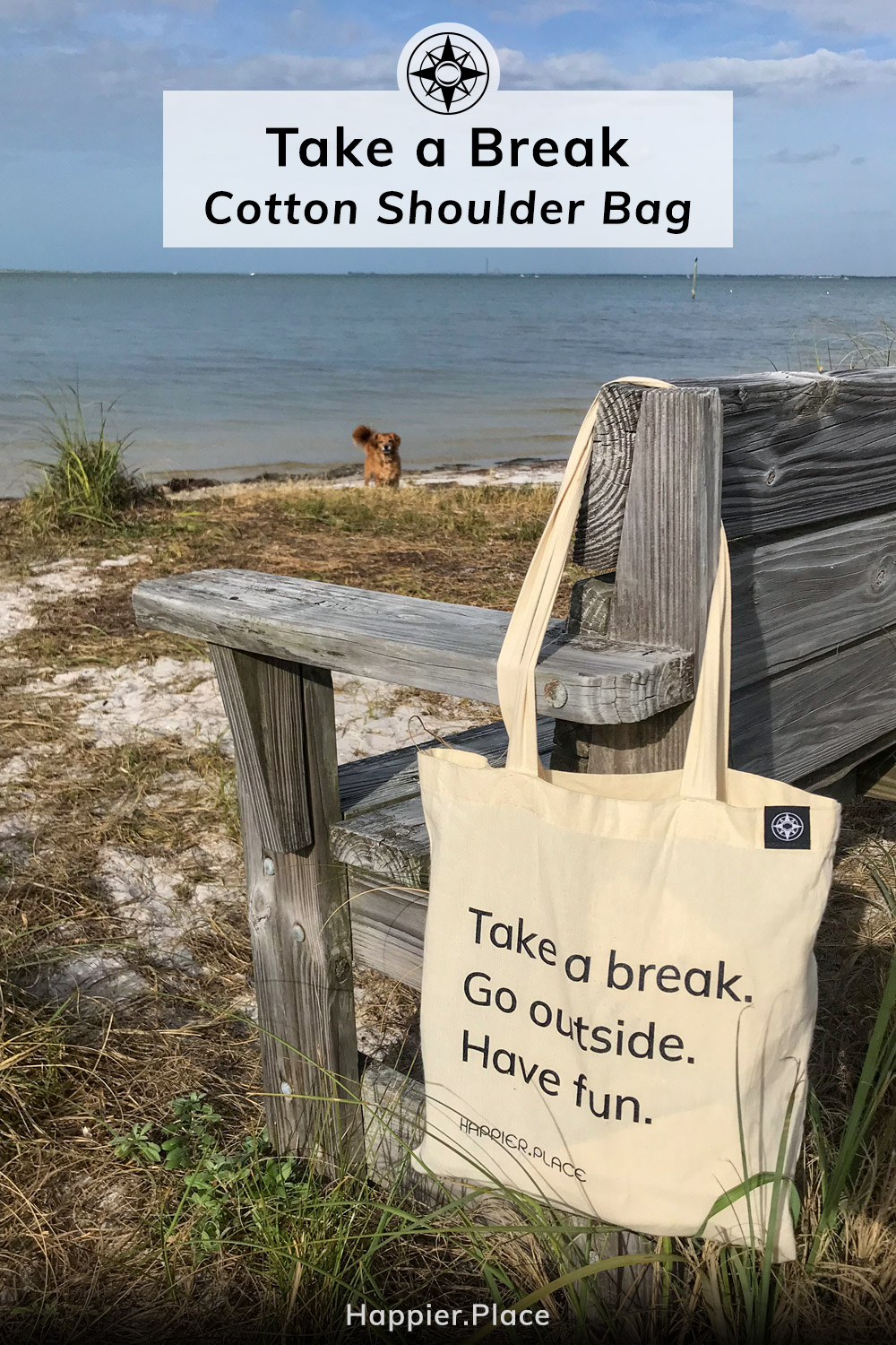 "The ""Take a break. Go outside. Have fun"" Happier Place cotton shoulder bag hanging on a beach bench in Florida. Added fun: Whiskey Dog!"