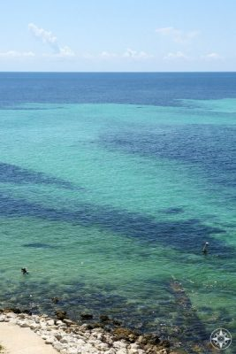 Perspective: person snorkeling just off Loggerhead Beach at the bottom left, and all the clear water to be explored beyond. But beware of the current! Bahia Honda Key State Park, Florida Keys, HappierPlace