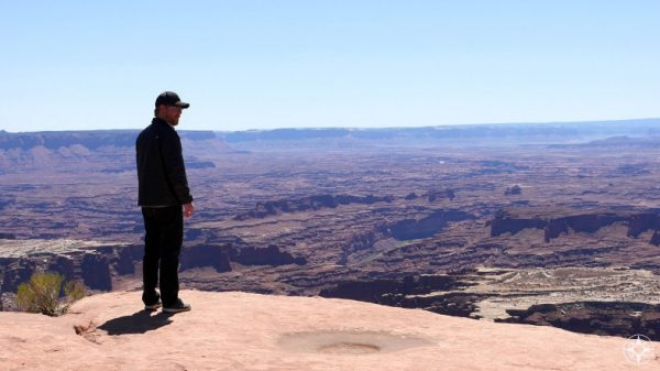 Scott near Grand View Point Overlook, taking in the breathtaking landscape of the southern part of Canyonlands.