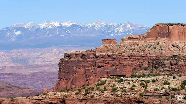 """Part of the large """"Island in the Sky"""" mesa and the La Sal Mountains seen from Island in the Sky itself."""
