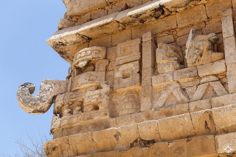 Detail of the La Iglesia facade building corner: Mask with distinct nose, horse and headless guy, Chichen Itza