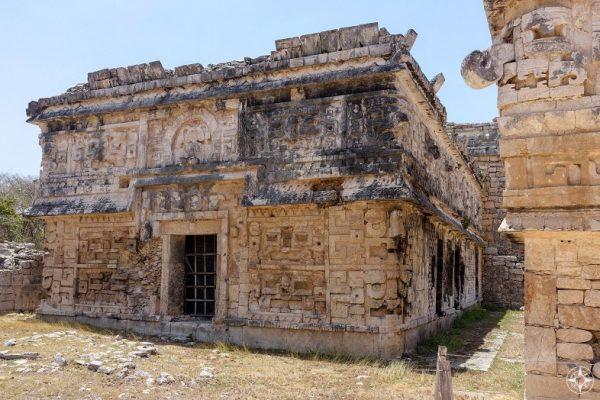 Maya ruin, intricate facade of building in the Las Monjas Group, Chichen Itza, Mexico