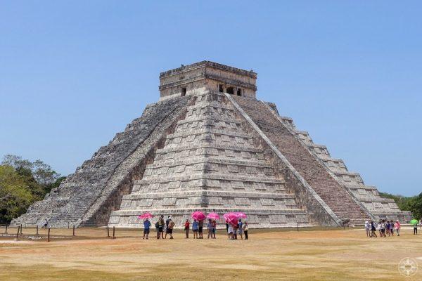 Pink umbrellas before the Wonder of the World, Chichen Itza pyramid El Castillo, Temple of Kukulkan, Yucatan, Mexico, Happier Place