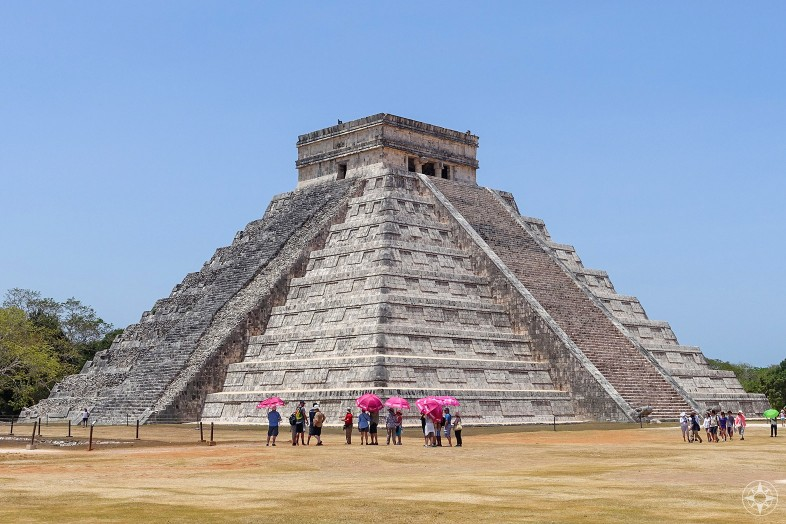 Pink umbrellas before the Wonder of the World, Chichen Itza pyramid El Castillo, Temple of Kukulkan, Yucatan, Mexico, Happier Place