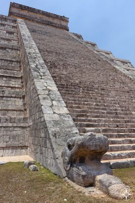 Left snake head on the north-east side of El Castillo pyramid, Chichen Itza, Mexico