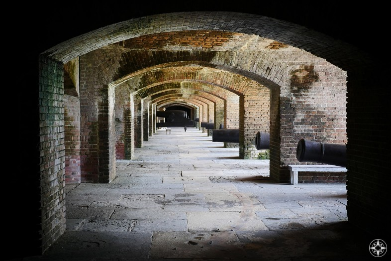 Fort Zachary Taylor canons lined up with windows over the moat