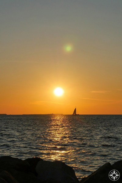 One more sunset with sailboat from the rock wall jetty in the Florida State Park on Key West.