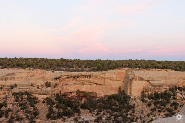 If you didn't know they were there... Ancient Pueblo cliff dwellings in Mesa Verde at sunset.