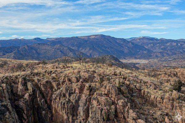 Royal Gorge granite wall, burned trees, and the Sangre de Cristo Mountain Range.