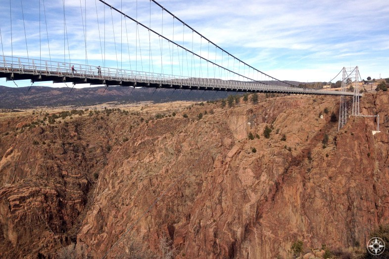 People walking across Royal Gorge Bridge suspended high above canyon wall, Canon City, Colorado