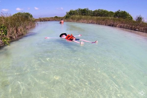 Pure relaxation: floating in the current along a Maya trade canal held up by a life vest.