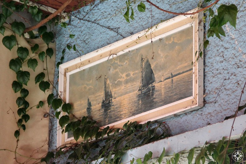 Ivy grows over a sailboat painting. Nature takes back... at Schleusenkrug, a restaurant inside Tiergarten.