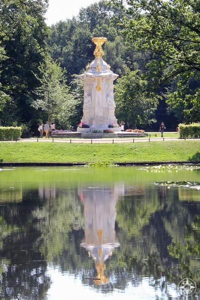 Beethoven-Haydn-Mozart Memorial reflected in a pond in the Tiergarten park.