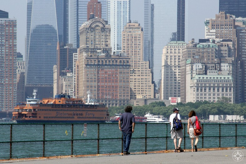Staten Island Ferry cruising by the Financial District in Manhattan as seen from Governors Island.